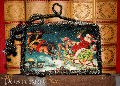 Christmas ornament of Santa Claus in his sleigh