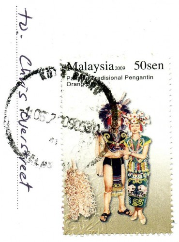 Malaysian postage stamp showing traditional dress
