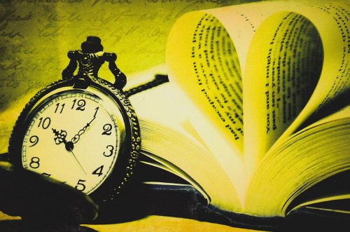 Leafed Book and Old Clock (E15)